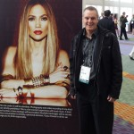 Paul with J Lo poster